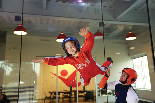 Kid at iFLY indoor skydiving